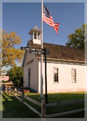 1889 Territorial School and flag pole